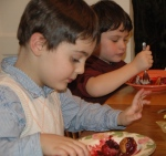 Sam and Caleb enjoying Chanukah dessert