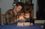 Sadie and Jesse lighting menorah