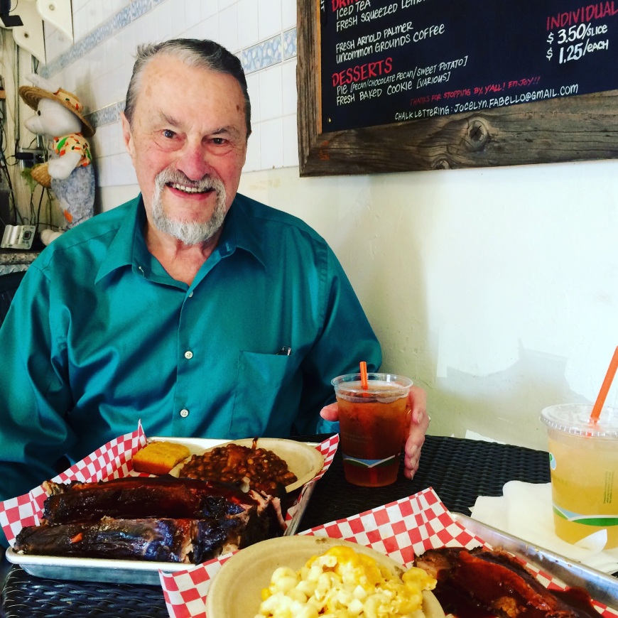 My dad Manny, with a perfect portion of ribs and some sweet tea.