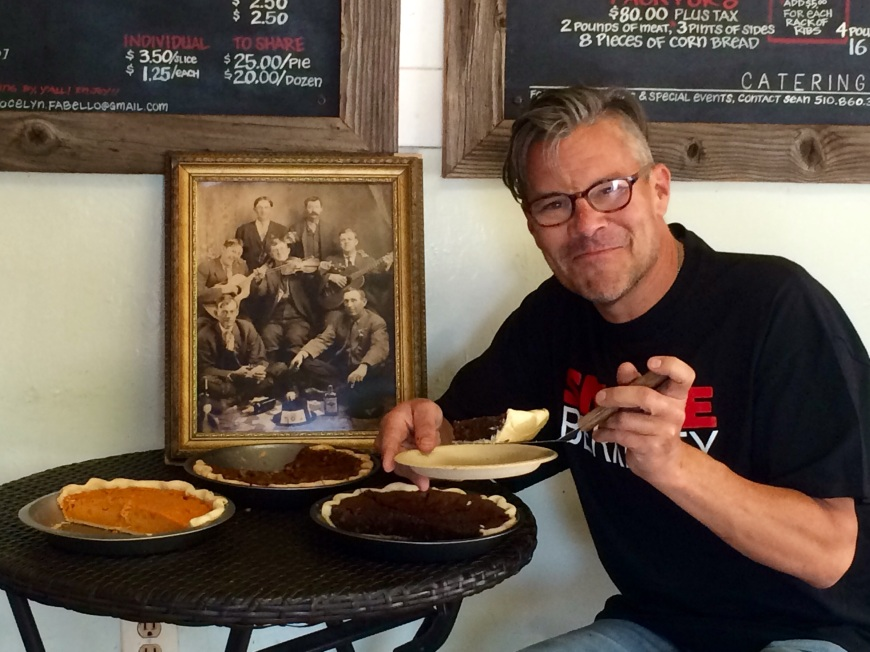 Sean, our gracious pie pusher, sitting beside a photo of his ancestors from Texas.